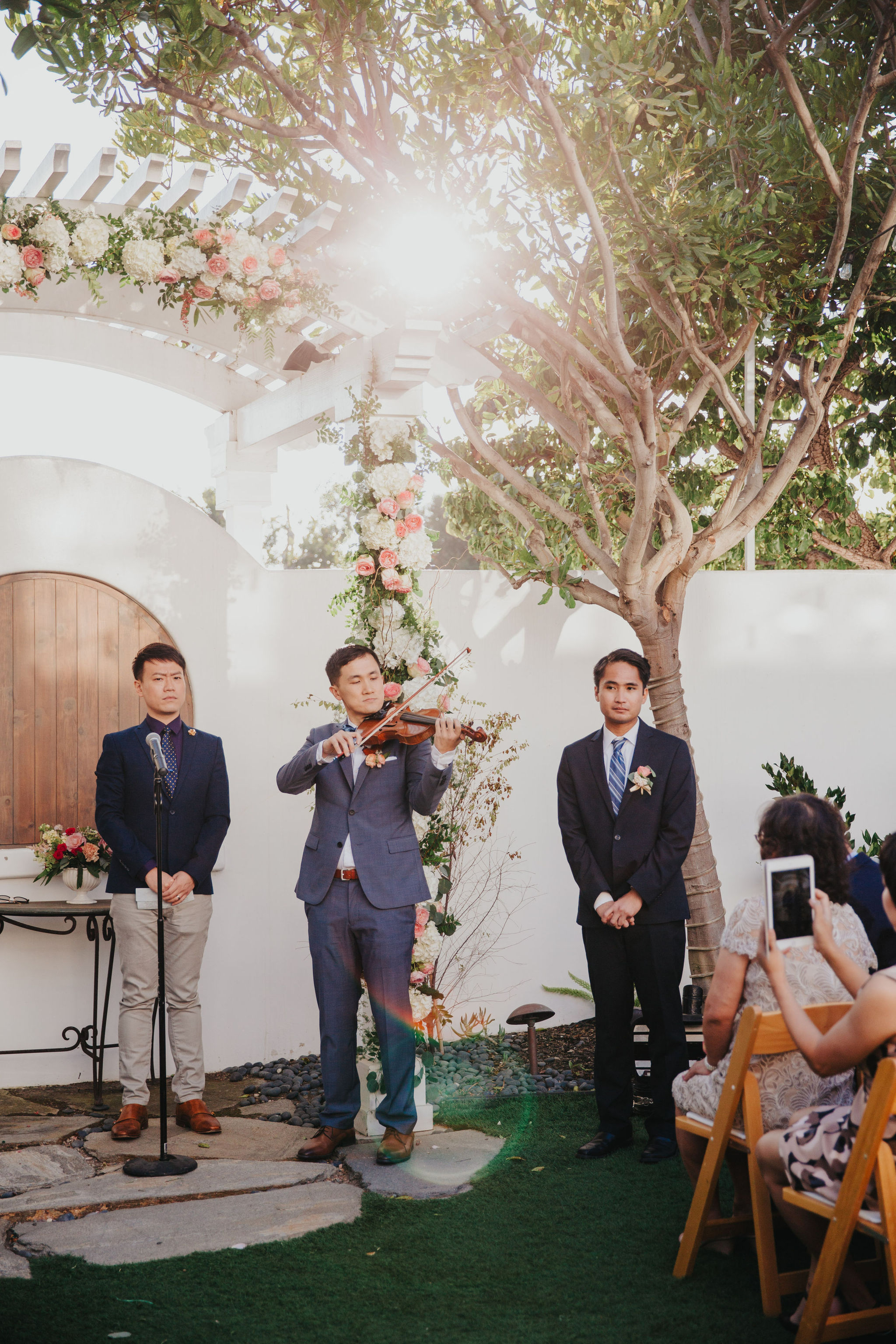 Groom Playing Violin | Verandas Beach House